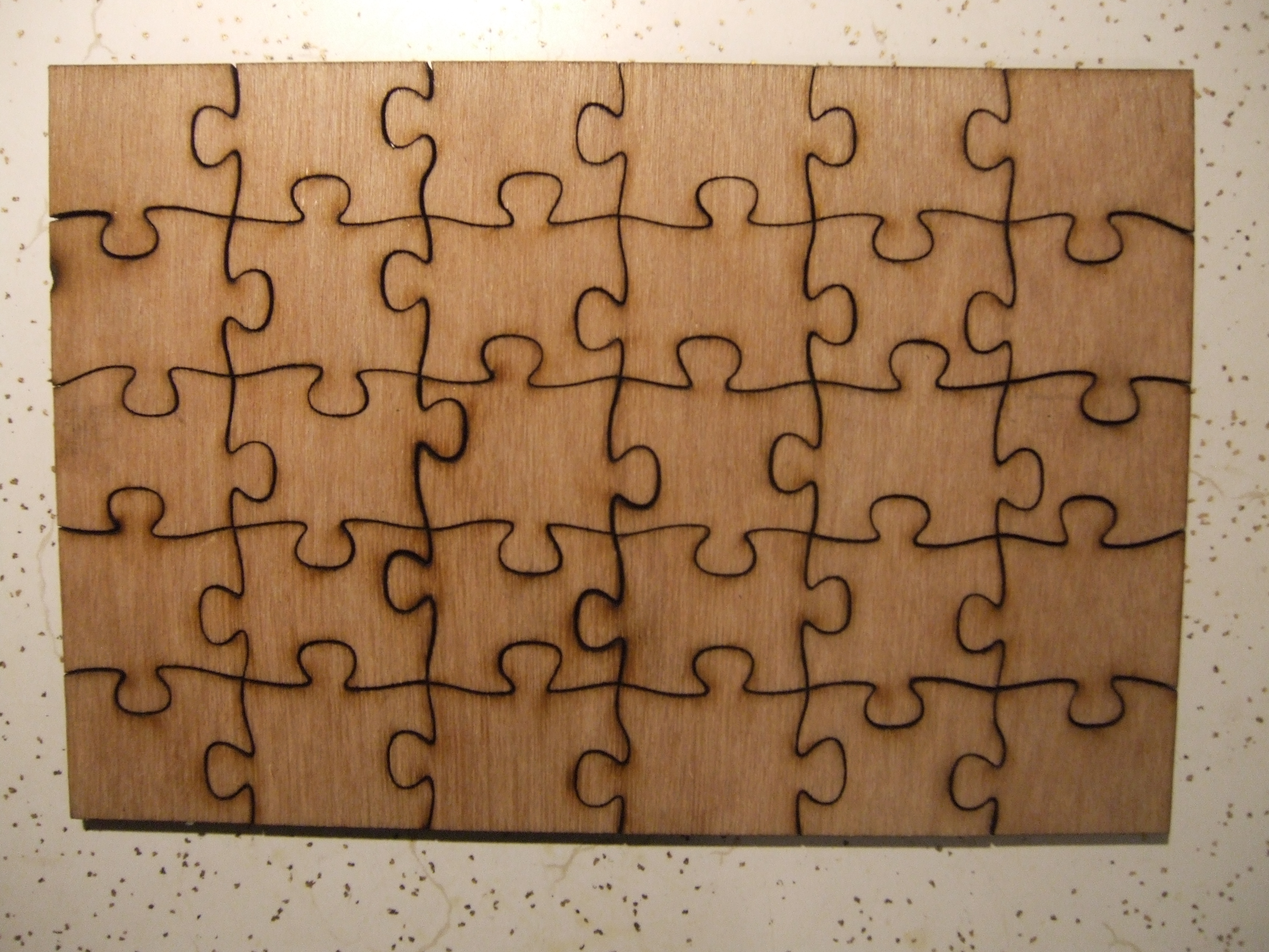 Laser cut jigsaw puzzles makeit labs for Puzzle cut out template
